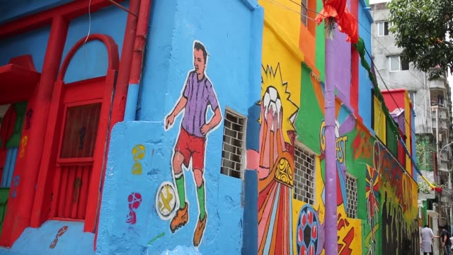 bangladeshi people walks through next to a wall painted by soccer fans during the 2018 fifa world cup in russia in dhaka , bangladesh on july 10,... - fifa stock videos & royalty-free footage