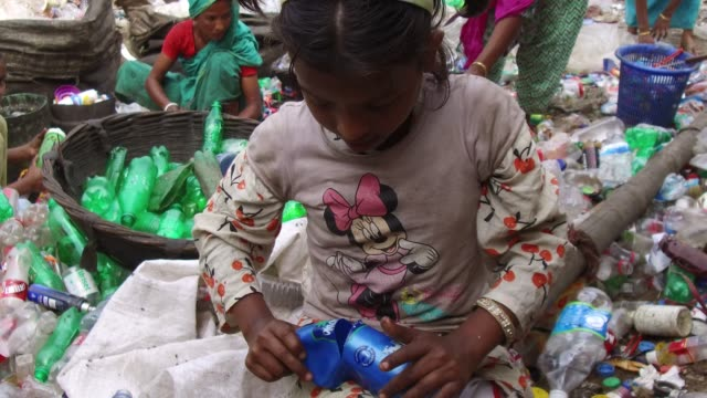 bangladeshi people work in a plastic bottle recycling factory in dhaka bangladesh on february 08 2018 after removing the labels and caps and... - climate finance stock videos & royalty-free footage