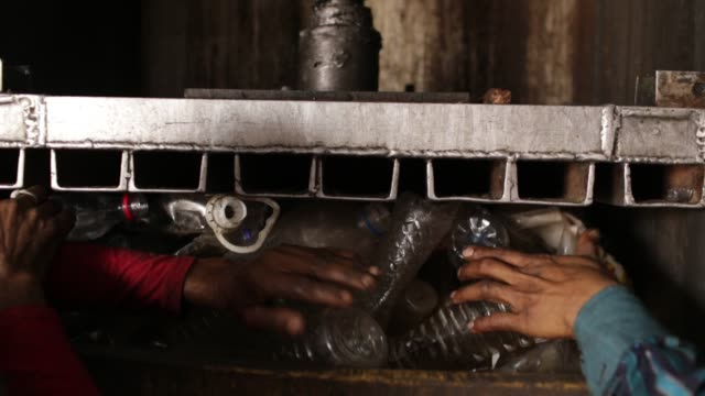 bangladeshi people works in a plastic bottle recycling factory in dhaka, bangladesh, on february 08, 2018. after removing the labels and caps, and... - other stock videos & royalty-free footage