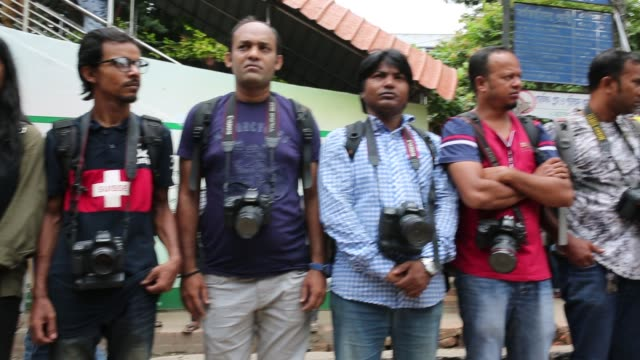 Bangladeshi photojournalists and journalists form a human chain in front of National Press Club protesting the attacks on them during the students'...