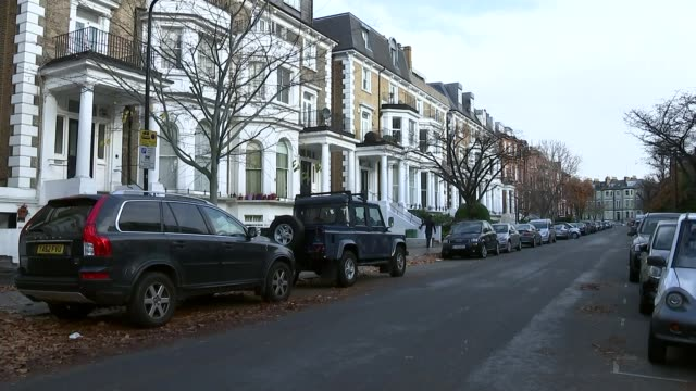 Bangladeshi PM refuses to answer questions on human rights record T13121721 / London Hampstead EXT Cars parked along street Hedge with 'Vote Labour'...