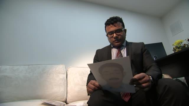 Bangladeshi PM refuses to answer questions on human rights record Rasel Shariar looking at photograph