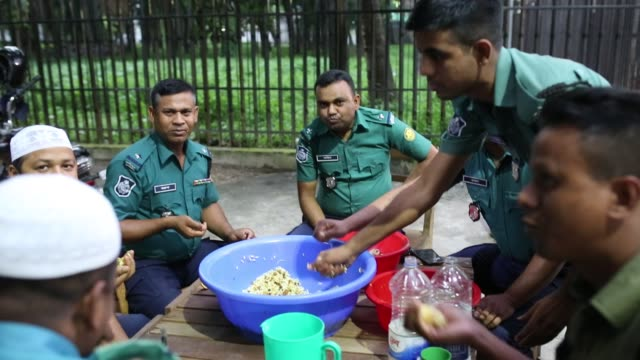 Bangladeshi police taking fastbreaking dinner during the Islamic holy month of Ramadan at the High Court area in Dhaka Bangladesh on May 19 2018