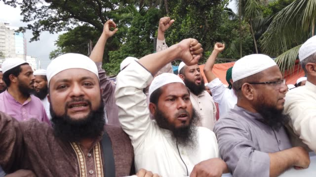 bangladeshi political group islami andolan bangladesh to protest against recent situation on kashmir in neighboring india in dhaka bangladesh on... - people in a line stock videos & royalty-free footage