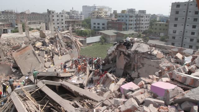 bangladeshi rescue workers and civilian volunteers assist in rescue operations after an eight-storey building collapsed in savar, on the outskirts of... - collapsing stock videos & royalty-free footage