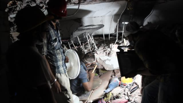 bangladeshi rescue workers and civilian volunteers assist in rescue operations after an eightstorey building collapsed in savar on the outskirts of... - savar stock videos and b-roll footage