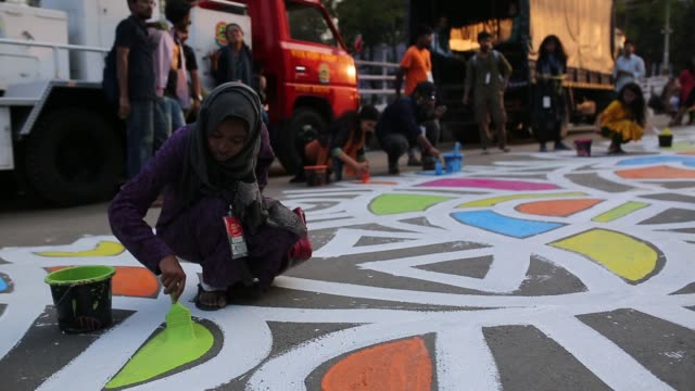 bangladeshi students paints on the street as part of the decoration for the international mother language day celebration in front of the language... - bangle stock videos & royalty-free footage