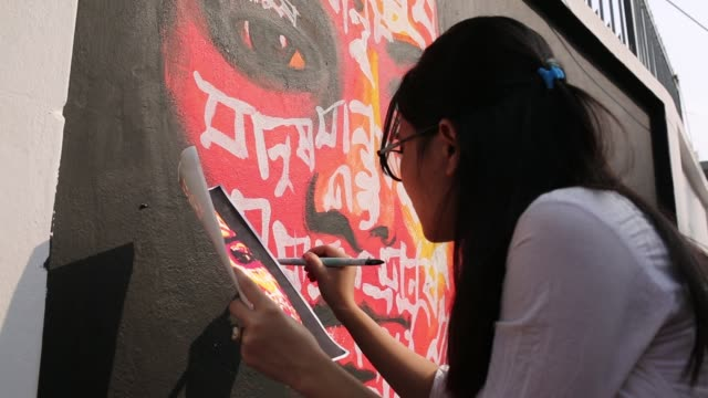 bangladeshi students paints on the wall as part of the decoration for the international mother language day celebration in front of the language... - bangle stock videos & royalty-free footage