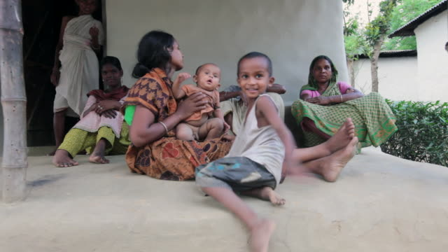 Bangladeshi women and a baby siting in front of their house,  in a village not far from Srimangal, Sreemangal (Srimangal), Division of Sylhet, Bangladesh, Indian Sub-Continent, Asia, Indian Sub-Continent, Asia