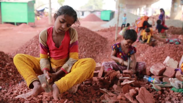 Bangladeshi women break bricks in Dhaka Bangladesh on March 06 2018 With over half of the population living below the poverty line women and children...
