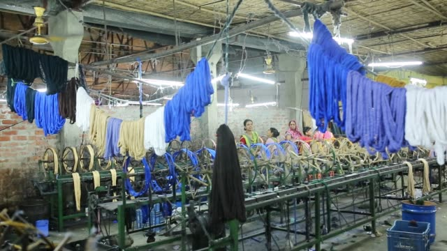 vidéos et rushes de bangladeshi workers busy with making cloths inside a factory in a rural area - bangladesh