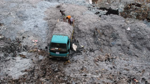 bangladeshi workers unload tannery waste at tannery industrial area on the banks of the daleshwari river in savar bangladesh more than 100 leather... - savar stock videos and b-roll footage