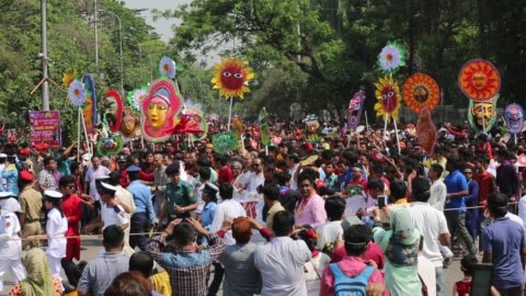 stockvideo's en b-roll-footage met bangladeshis attend a rally in celebration of the bengali new year or pohela boishakh in dhaka, bangladesh on april 14, 2017 / the day is celebrated... - festivalganger