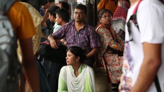 Bangladeshis cram onto a train as they travel back home to be with their families ahead of the Muslim festival of Eid alFitr in Dhaka Bangladesh