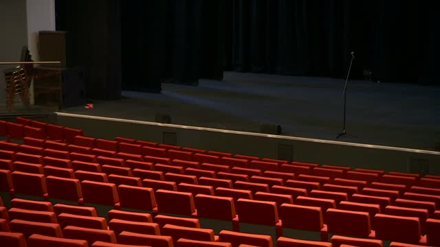 bank arena in liverpool general views; england: liverpool: m and s bank arena : int wide shot of empty seating in theatre auditorium, microphone on... - auditorium stock videos & royalty-free footage