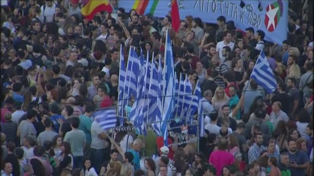 Bank closures as Greece heads for default on its debt GREECE Athens EXT Crowd of demonstrating government supporters on the streeets with Greek flags...