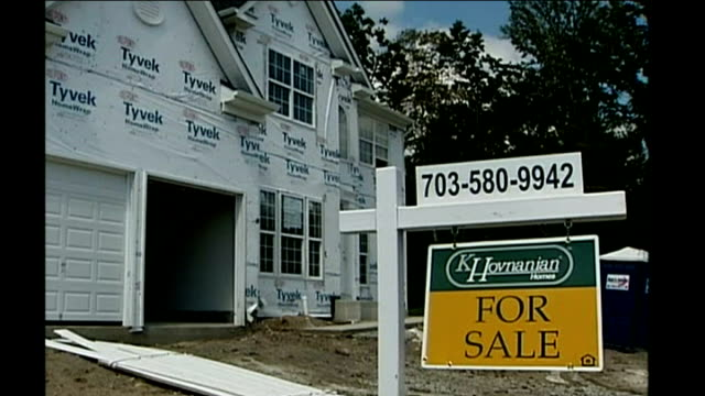 us rescue package/ markets rally lib northern virginia suburban houses for sale building worker using hammer on windows of period house large houses... - 売り出し中点の映像素材/bロール