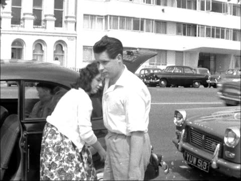vídeos de stock e filmes b-roll de bank holiday traffic en route to the south coast england ext reporter to camera reporter lighting cigarette at wheel of car brighton vox pops... - east sussex