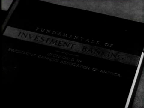 vídeos y material grabado en eventos de stock de b/w montage bank investment expert giving professional trainning to other officers, united states / audio - 1952