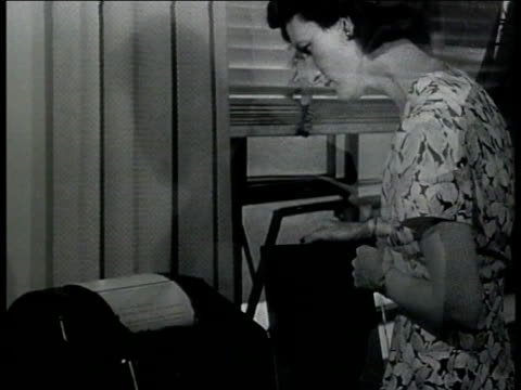 bank manager talking to official at desk showing papers ms woman receiving message from teletype machine treasury department cu teletype telegram vs... - telegram stock videos and b-roll footage