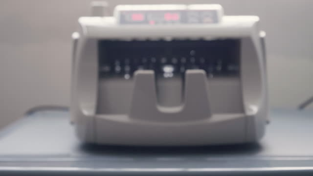 bank money counting machine - money makes the world go around stock videos and b-roll footage