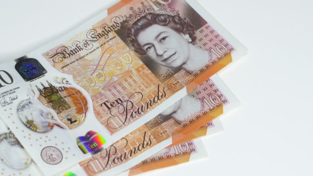 uk bank notes being counted out. - investment stock videos & royalty-free footage