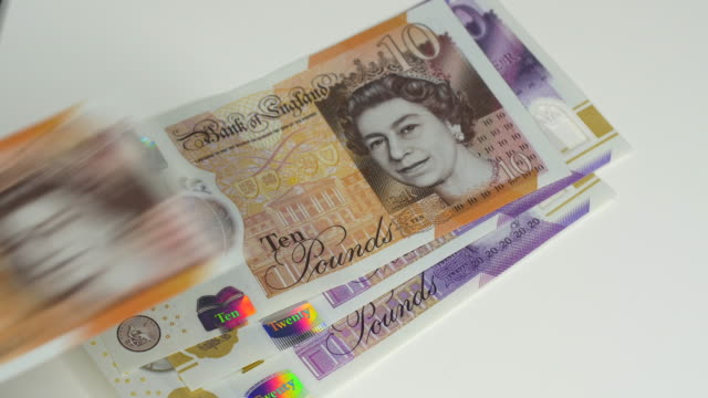 uk bank notes being counted out. - pound sterling symbol stock videos & royalty-free footage