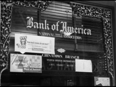 chinatown bank of america chinatown branch office sign ha ws asian people in several bank teller lines asian men filling out deposit slips at counter... - bank of america stock videos & royalty-free footage