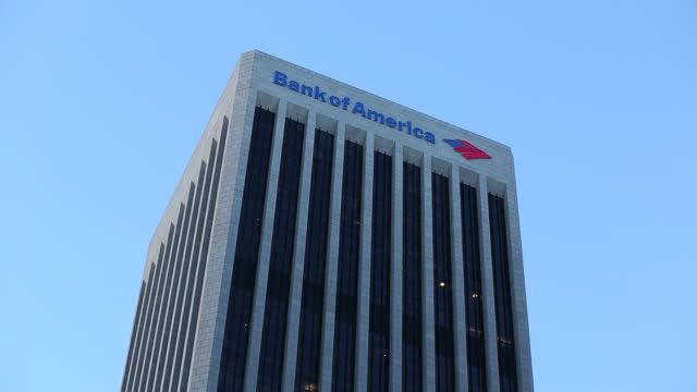 bank of america corp signage is displayed on the bank of america plaza tower in los angeles california us on monday july 13 2015 shots wide shots pan... - bank of america stock videos & royalty-free footage