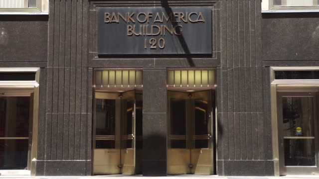 bank of america locations in downtown chicago il on july 9th 2017 shots wide shot of building exterior as pedestrians walk by sidewalk wider shot... - bank of america stock videos & royalty-free footage