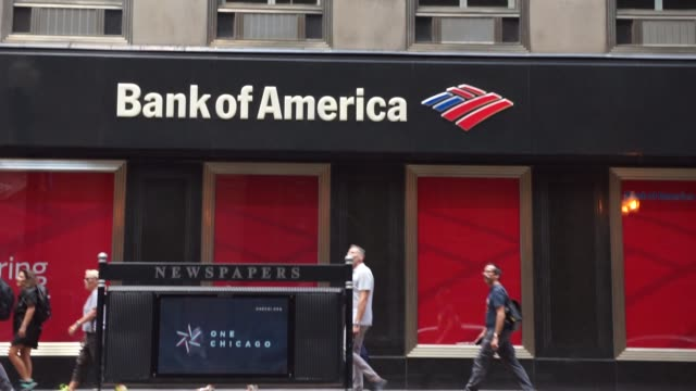 bank of america locations in downtown chicago il on july 9th 2017 shots shot of bank of america signage near newspaper stand shot of reflection of... - bank of america stock videos & royalty-free footage