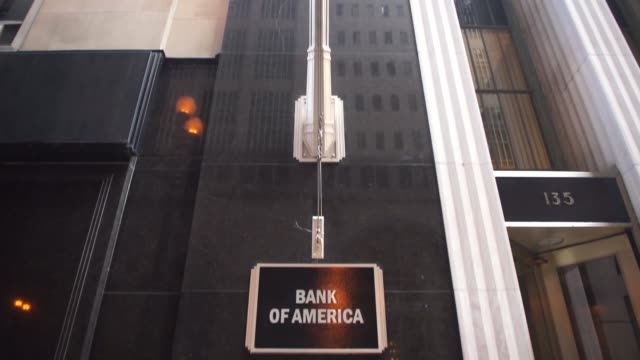 bank of america locations in downtown chicago il on july 9th 2017 shots pan left of bank of america sign near door tilt down of same subject... - bank of america stock videos & royalty-free footage