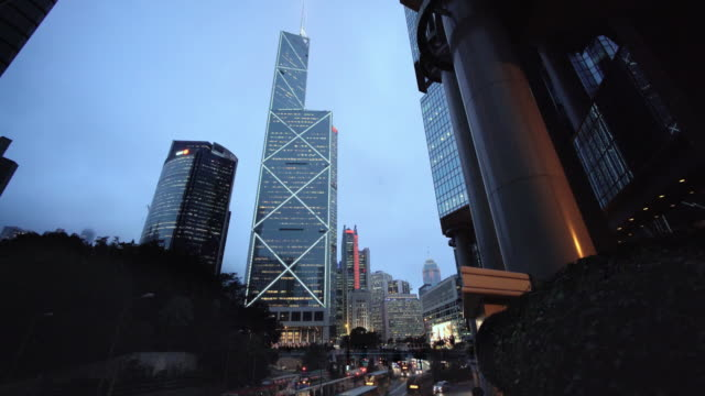 bank of china tower, hsbc and other bldgs at dusk, hong kong - bank of china tower hong kong stock videos & royalty-free footage