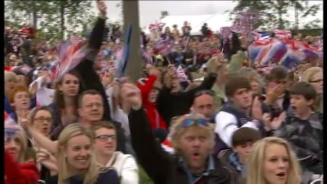 bank of england cuts growth forecast stratford olympic park ext england fans waving flags pan - ファイサル・イスラム点の映像素材/bロール