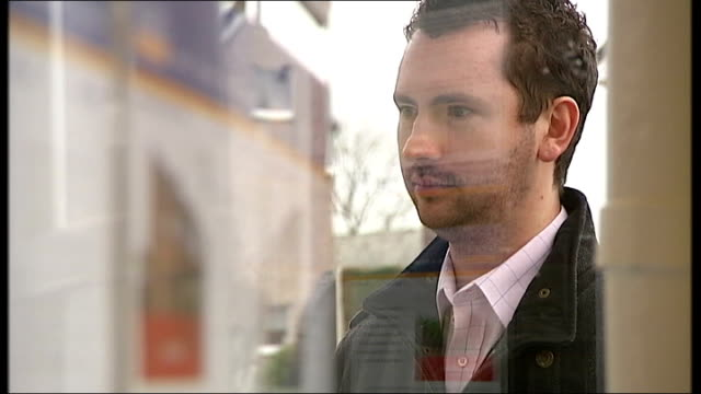 bank of england cuts interest rates by 15 per cent wales hawarden int various views of man looking at house advertisements in window of real estate... - for sale englischer satz stock-videos und b-roll-filmmaterial