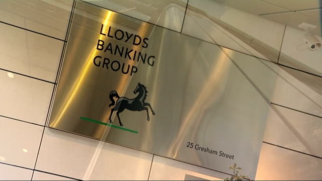 bank of england expands quantitative easing; lloyds banking group sign on wall low angle view of side of office building 'to be the best' sign - banking sign stock videos & royalty-free footage
