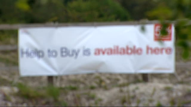 Bank of England warn house market boom is 'biggest risk' to economic recovery R20051322 / Chinnor Banner 'Help to Buy is available here' on fence