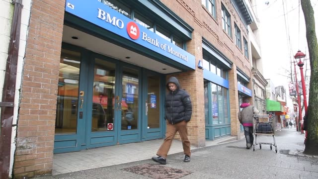 Bank of Montreal signage is displayed outside a branch in Vancouver British Columbia Canada on Monday Feb 24 The logo and signage of Toronto Dominion...