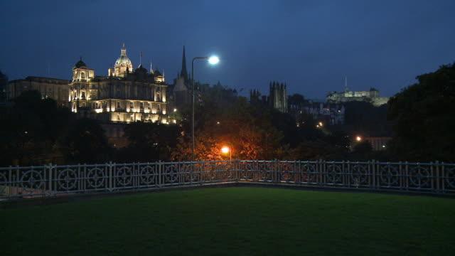 ws, bank of scotland  illuminated at night, edinburgh castle in background, edinburgh, scotland, united kingdom - edinburgh castle stock videos & royalty-free footage