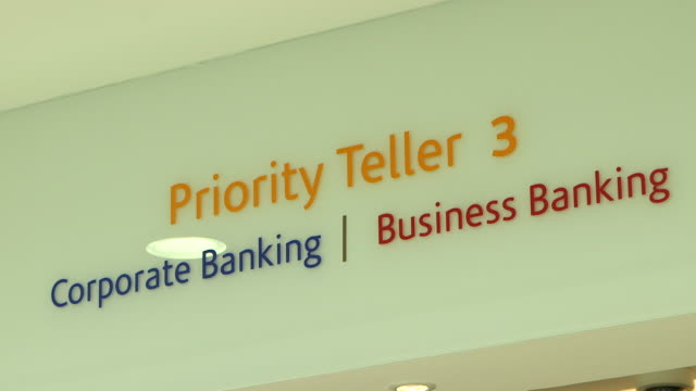 bank signs. low-angle on an information sign inside a bank for: priority teller, corporate banking, business banking. - banking sign stock videos & royalty-free footage