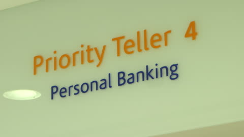 bank signs. low-angle on an information sign inside a bank for: priority teller, personal banking. - banking sign stock videos & royalty-free footage
