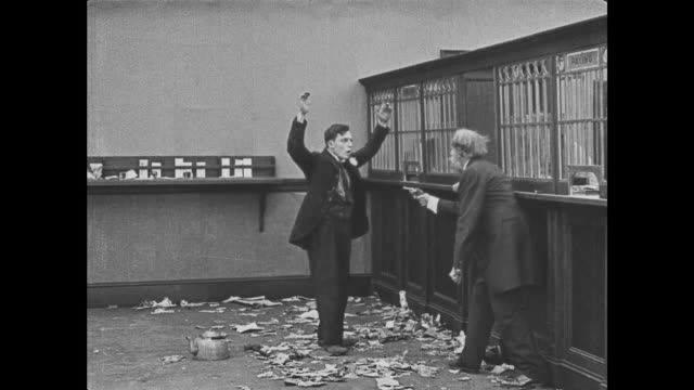 1921 Bank teller accidentally misfires gun scaring off bank robbers and confusing management