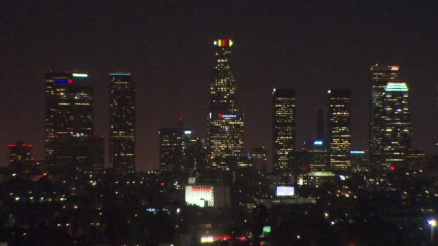 s bank tower lit up in belgium flag colors - us bank tower stock videos & royalty-free footage