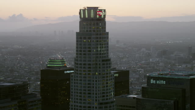 us bank tower skyscrapers in los angeles, at dusk, viewed from an aerial perspective. - us bank tower stock videos & royalty-free footage