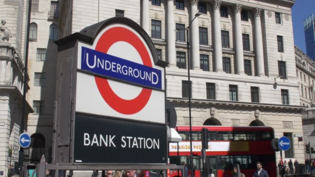 bank underground station entrance and passing traffic. city of london. - sign stock videos & royalty-free footage