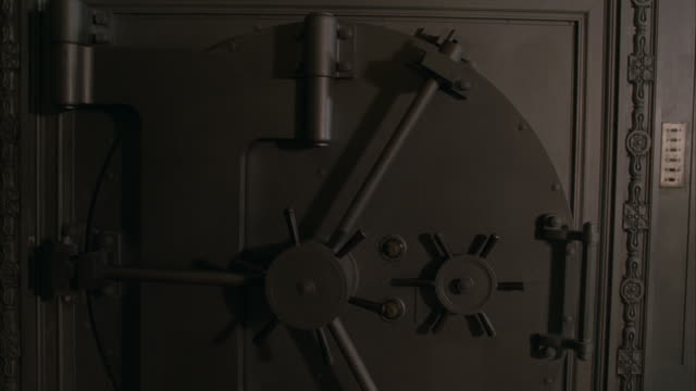 a bank vault door slowly swings open. - banking stock videos & royalty-free footage