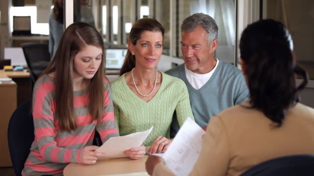 MS Banker Discussing College Loans with Teenager and Parents / Richmond, Virginia, USA