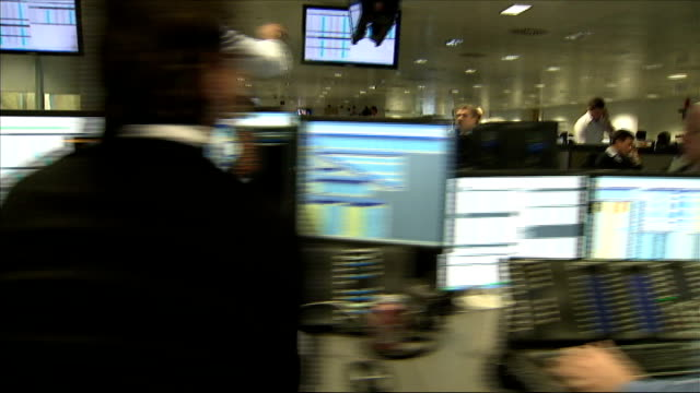 barclays to be investigated over alleged fixing of foreign exchange currency markets; people queueing at currency exchange desk cash handed over... - banking sign stock videos & royalty-free footage