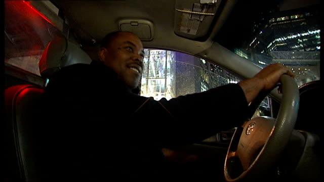bernard madoff financial scandal; night **radio station heard over following** point of view shots from taxi as through busy manhattan streets - manhattan video stock e b–roll