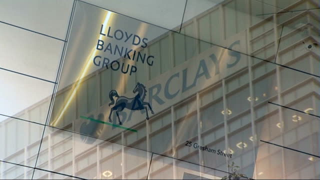 chancellor george osborne announces bank levy increase; ext lloyds banking group building entrance and sign barclays skyscraper and sign hsbc... - banking sign stock videos & royalty-free footage